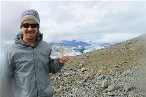 Mr. Pascale holding a piece of a glacier in Iceland